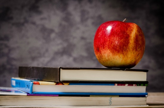 two school books and an apple