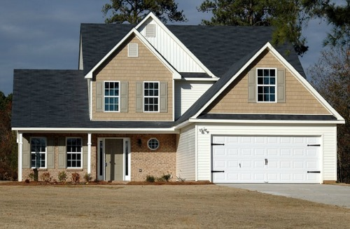 new construction home with brick and large garage