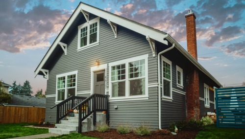 pre-owned home with grey siding
