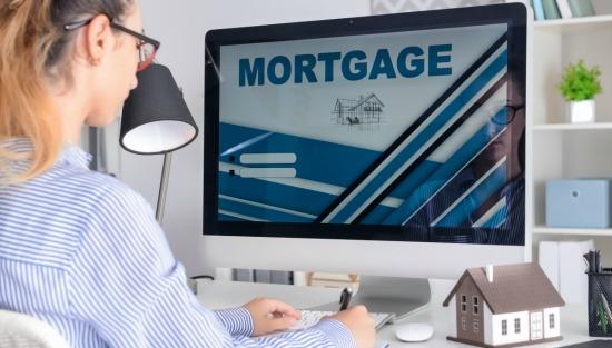 Woman looking at mortgage screen