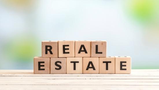letter blocks spelling real estate