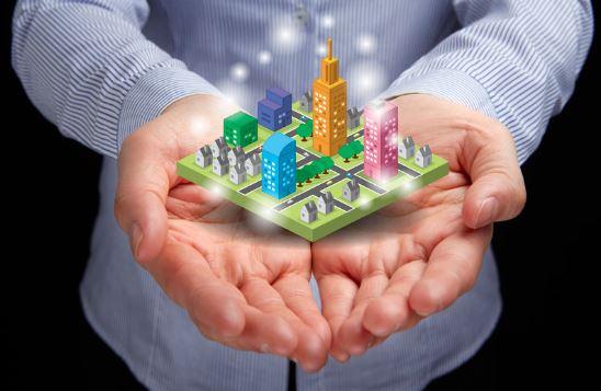 hands holding a 3D model city