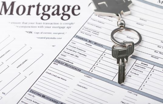 Mortgage Loan Application with Key on House Keychain