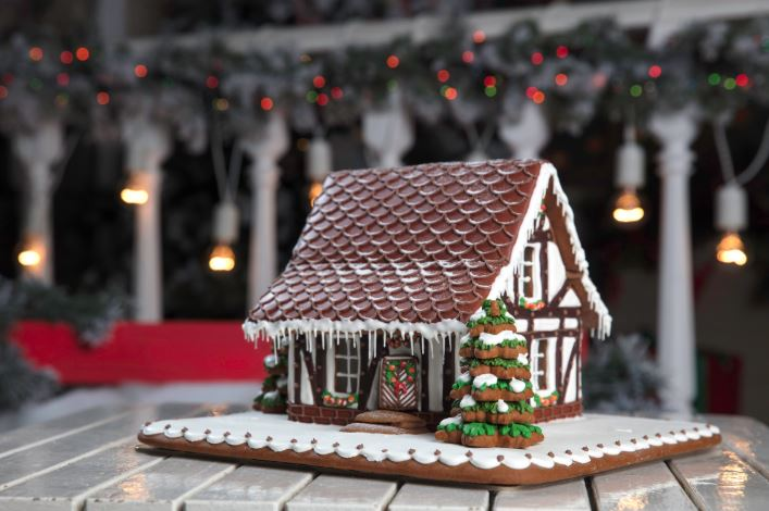 Gingerbread house on white table