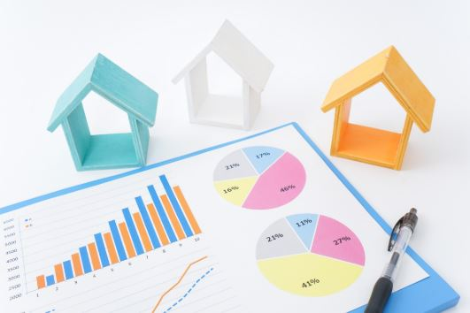 Real Estate Market Report Concept model houses and charts