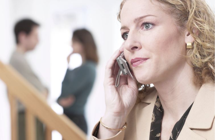 Woman looking unhappy on phone