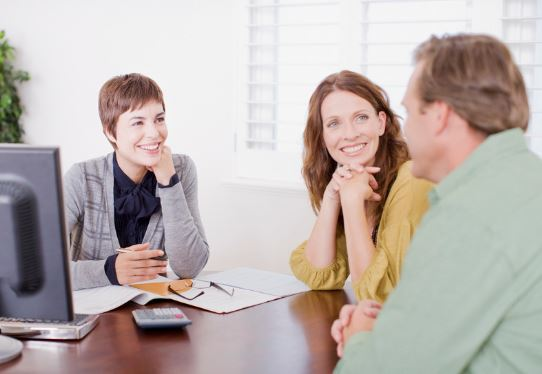 Female real estate agent with couple