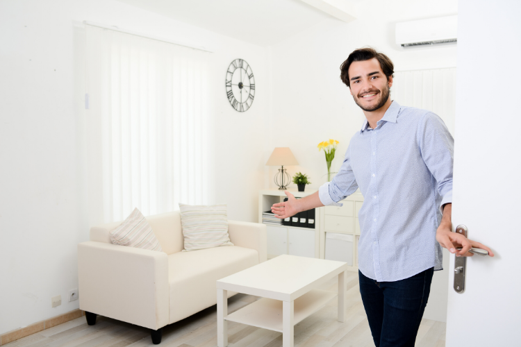 Man Showing Entrance to Open House