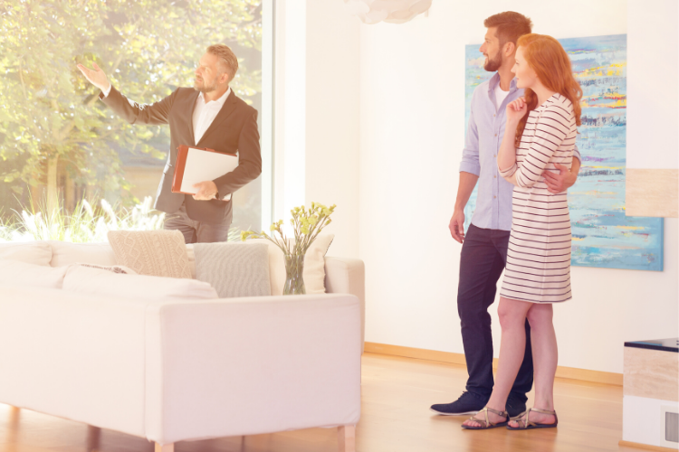 People looking inside house real estate agent