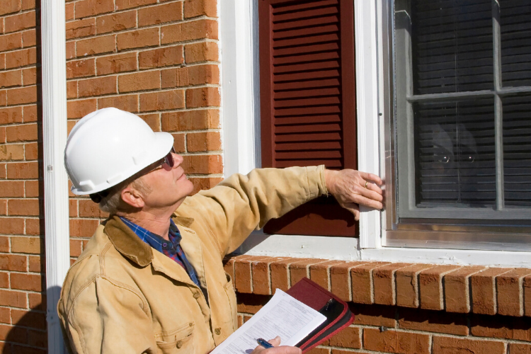 home inspector holding a home inspection checklist