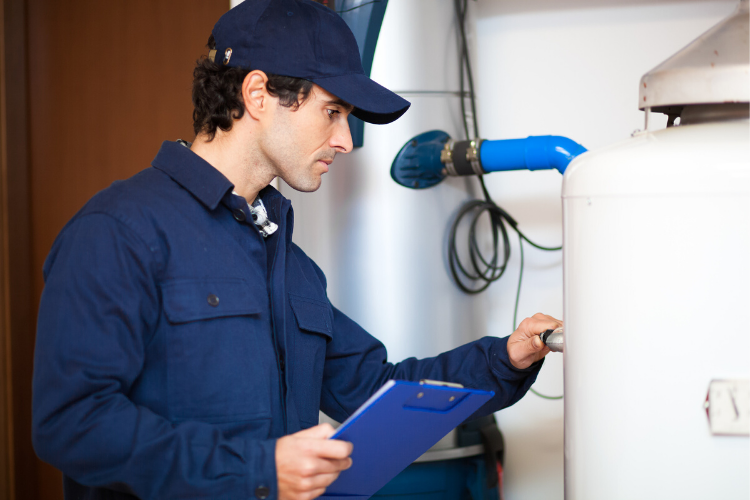 home inspection tips for sellers - man inspecting water heater